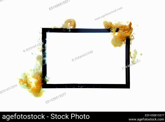 Gold acrylic flows over black frame isolated on white