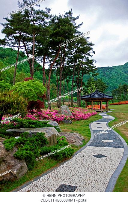 Paved path and garden in park