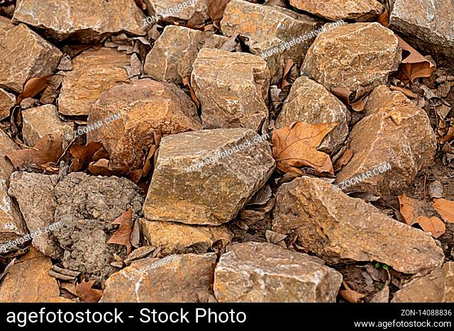 stone beige, brown pattern of many cobblestones weathered and solid, the background of the quarry