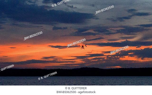 Quadrocopter on Lake Starnberg at dusk, Germany, Bavaria, Starnberg