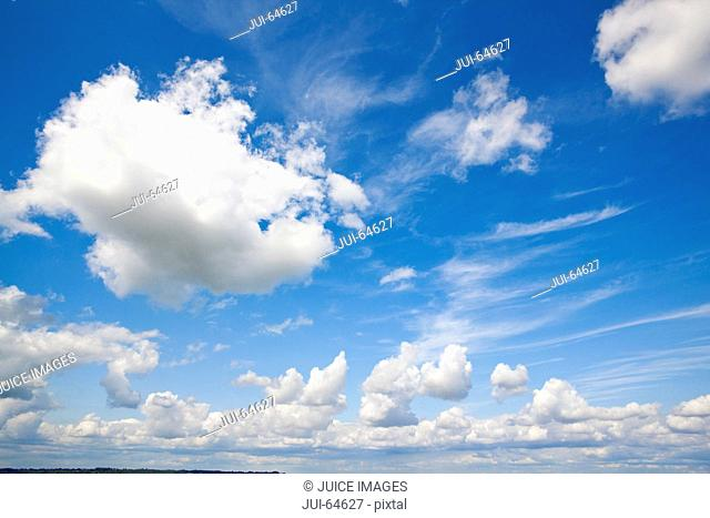 Blue sky with rolling white clouds