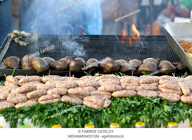 Jemaa El Fna place - Stuffed spleen grilled on barbecue and sausage on a stand