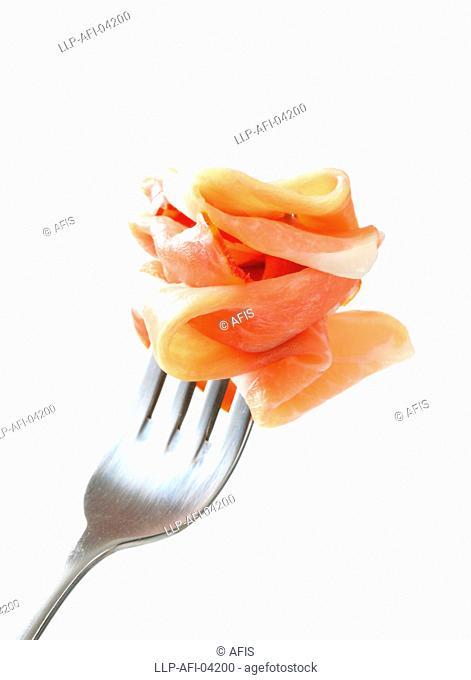 Prosciutto on a fork