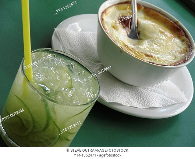 A drink of Caipriinha and bowl of Escondidinho at The Academia da Cachaca Restaurant, Leblon District, Rio de Janeiro, Brazil