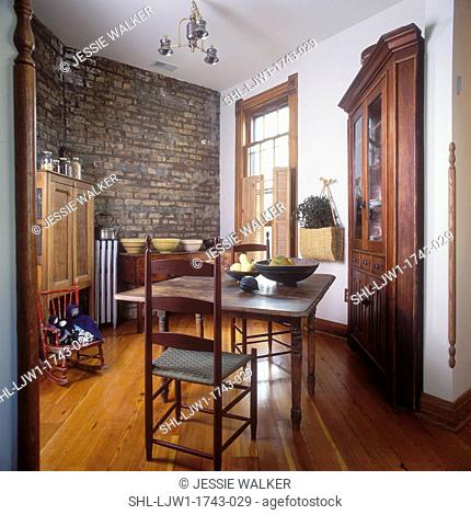 EATING AREAS - Interior of rooftop cottage, shaker style interior, antiques, wood floors and exposed brick wall, early farm table, ladderback chairs