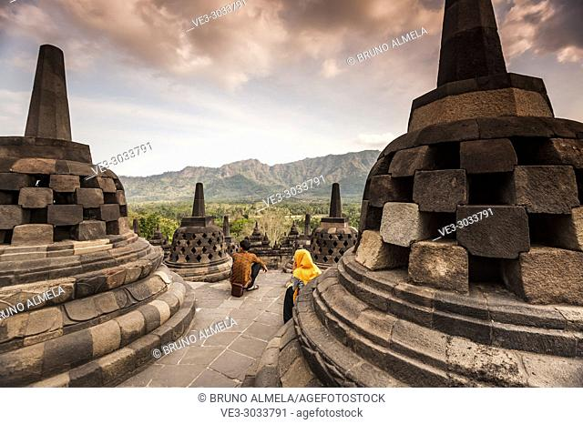 Indonesian tourists in Borobudur Temple, a UNESCO World Heritage Site in Magelang (Magelang Regency, Central Java, Indonesia)