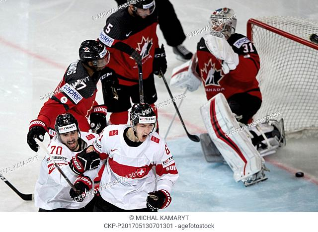 DENIS HOLLENSTEIN (front 2nd left) and FABRICE HERZOG (left) both of Switzerland celebrate a goal during the Ice Hockey World Championships match Canada vs...