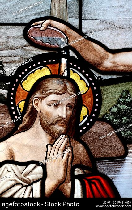 The baptism of Jesus by John the Baptist. Saint Thomas of Cantorbery church. Stained glass window. Cuiseaux. France