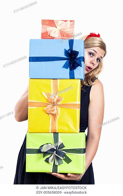 Surprised woman holding colorful presents, isolated on white background
