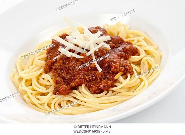 Bowl of spaghetti bolognese with parmesan cheese, close up
