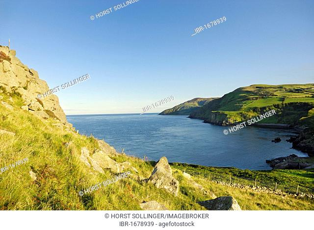 Coastal landscape with lush green cliffs, late afternoon mood at Torr Head, Northern Ireland, United Kingdom, Europe