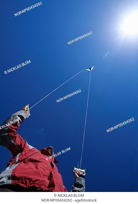 Man, kite and the shining sun