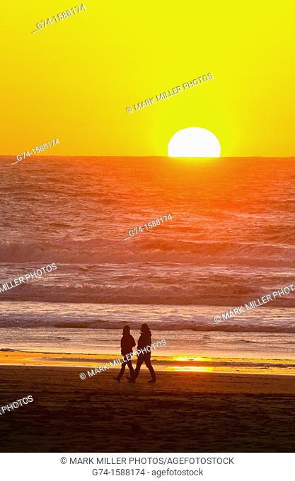 Hikiers on beach at Sunset San Francisco, California USA