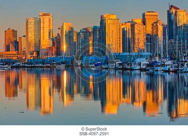 Reflection of buildings in water, Coal Harbour, Vancouver, British Columbia, Canada