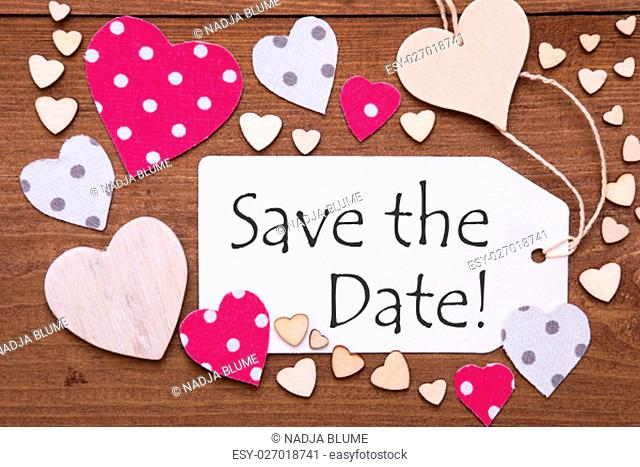 One Label With English Text Save The Date. Flat Lay View With Wooden Vintage Background. Pink Wooden And Paper Hearts