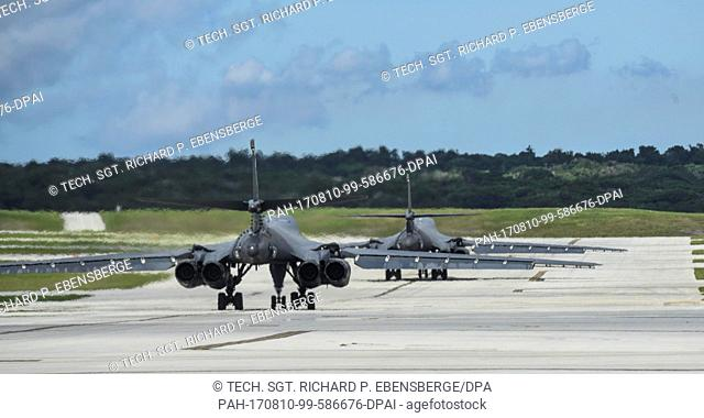 HANDOUT- Handout picture dated 09 July 2017 and made available by the US Air Force on 07 August 2017 showing two US B-1BLancer bombers rolling towards...
