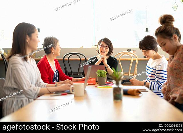 Five women in coworking office space