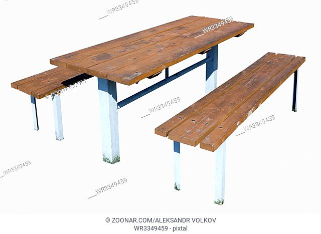 Outdoor summer table and benches for eating of a barbecue. Isolated with patch