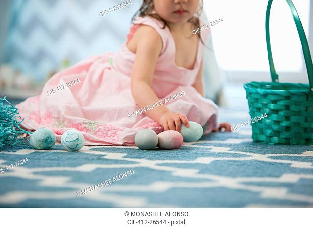 Girl in pink dress with Easter eggs
