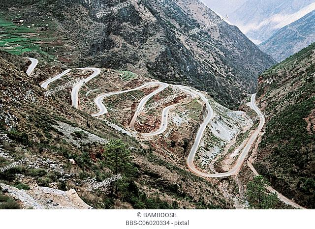 The winding mountain road of Shuzhengdi village, Ninglang County, Lijiang City, Yunnan Province of People's Republic of China