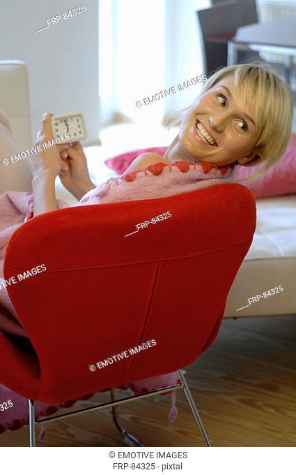 Woman setting the alarm clock