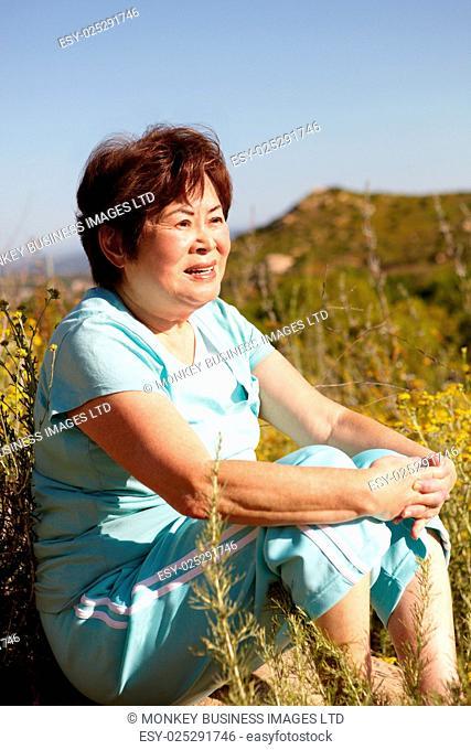 Senior woman sitting outdoors