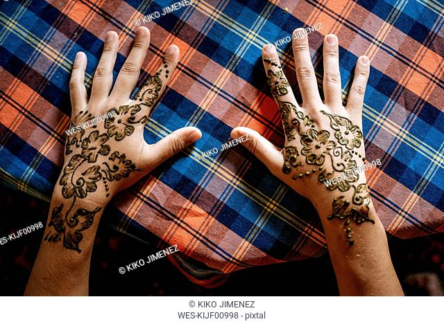 Henna painting on hands