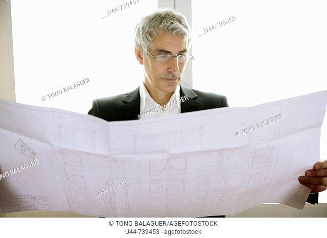 Matrure Architect looking at his plan