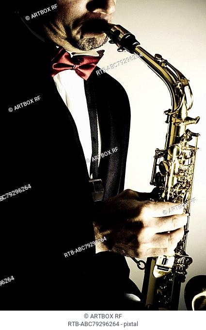 Close-up of a musician playing a saxophone