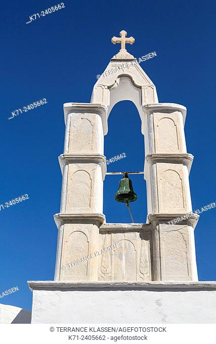 A church bell tower, dome and cross in Mykonos Town, Chora, Mykonos, Greece, Europe