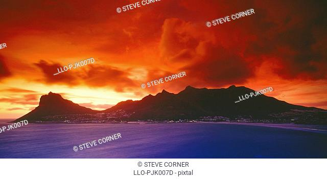 Dramatic red sky at sunset from Chapmans Peak looking towards Hout Bay. Cape Town, Western Cape Province, South Africa