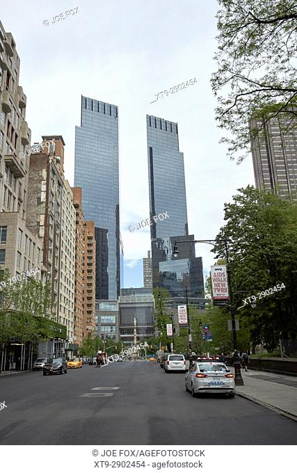 looking along central park south towards columbus circle and the time warner center New York City USA