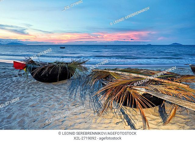 Traditional Vietnamese coracles at Cua Dai Beach at dusk. Hoi An, Quang Nam Province, Vietnam