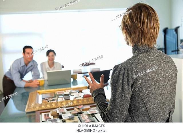 Rear view of a businesswoman standing in front of her two colleagues