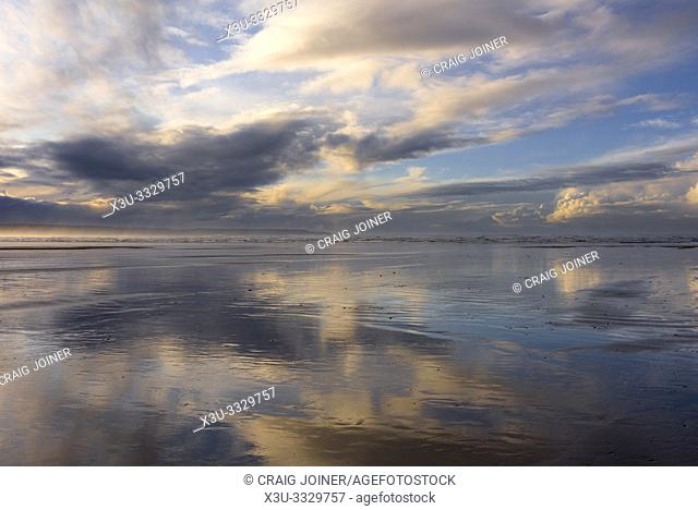 Clouds reflected in the wet sand at Westward Ho! beach, North Devon, England