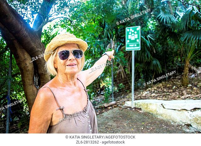 Senior retirred caucasian woman in her 60's, 70's doing the road of christ in Martinique