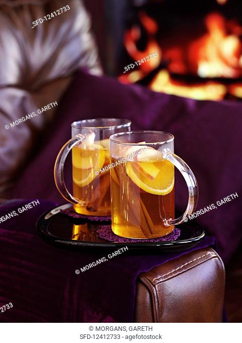 Hot fruit drinks with cinnamon sticks