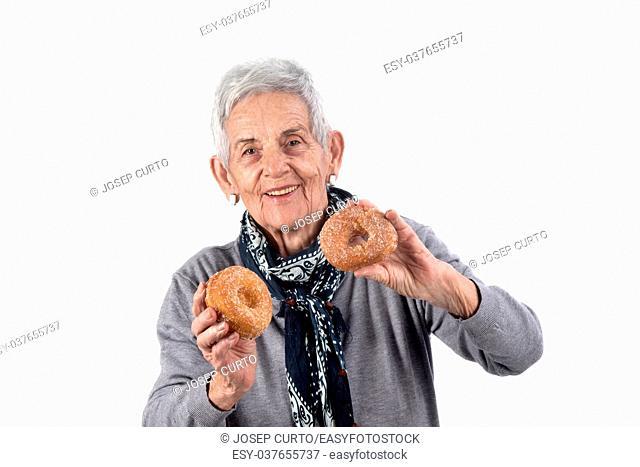 senior woman eating donut on white