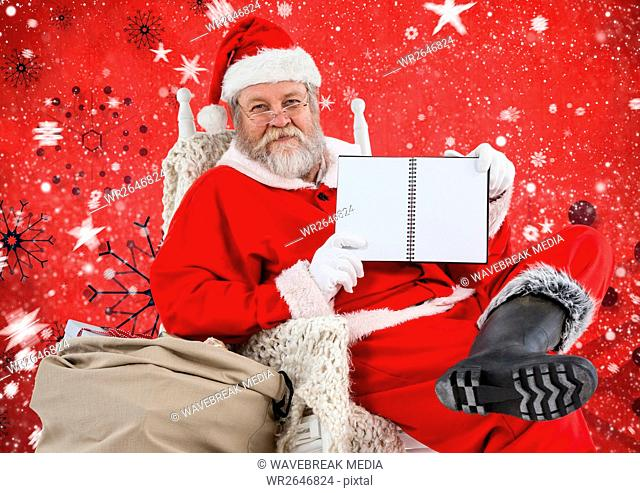 Santa sitting on chair and showing diary