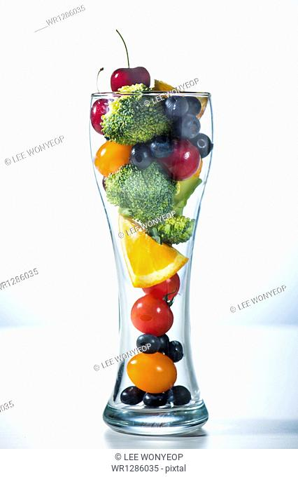 a glass filled with vegetables