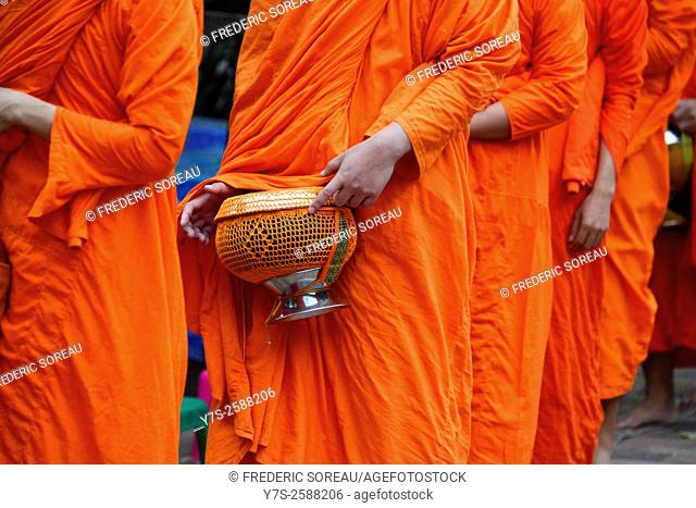 Monks collect food offerings from locals in Luang Prabang,Laos, South East Asia