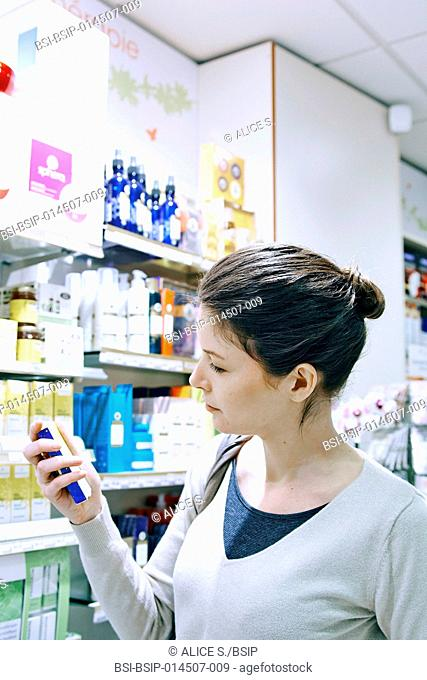 Woman holding Bach flower capsules