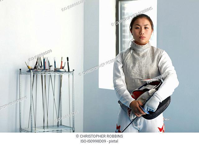 Portrait of teenage female fencer