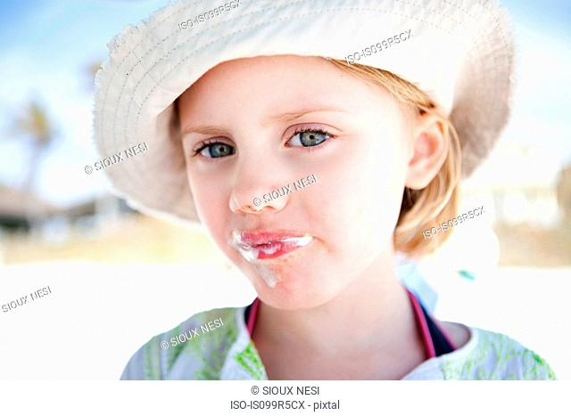 Little girl with ice cream around her mouth