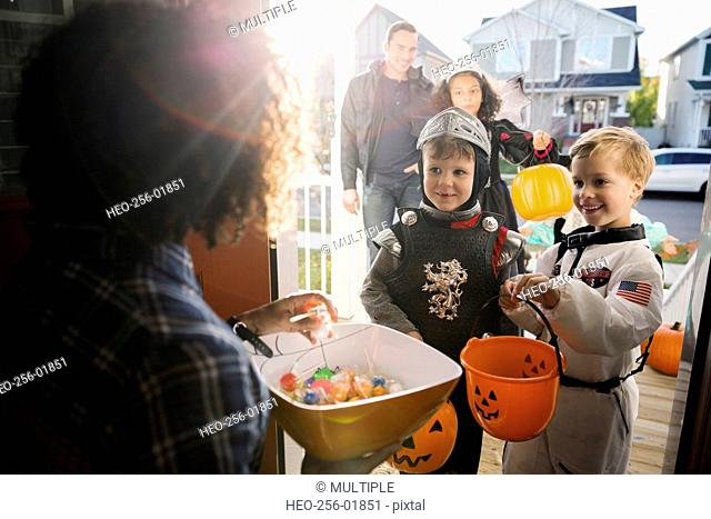 Woman with candy greeting trick or treaters