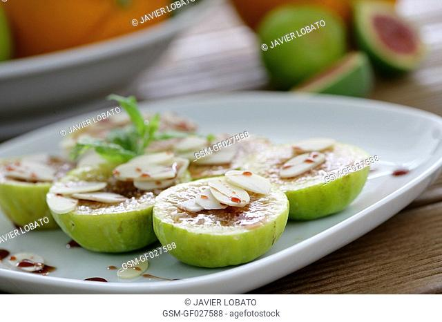 Sliced figs with almond sheets and Pedro Ximenez wine reduction