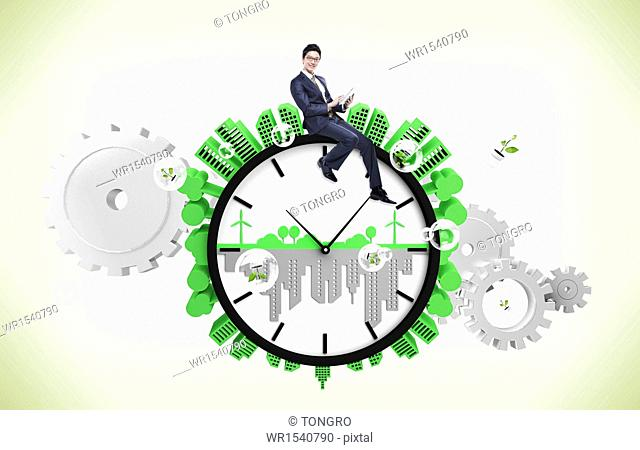 a business man sitting on a clock