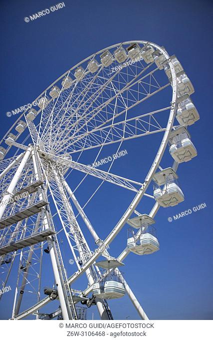New white ferris wheel in the blue sky in Viareggio Tuscany Italy