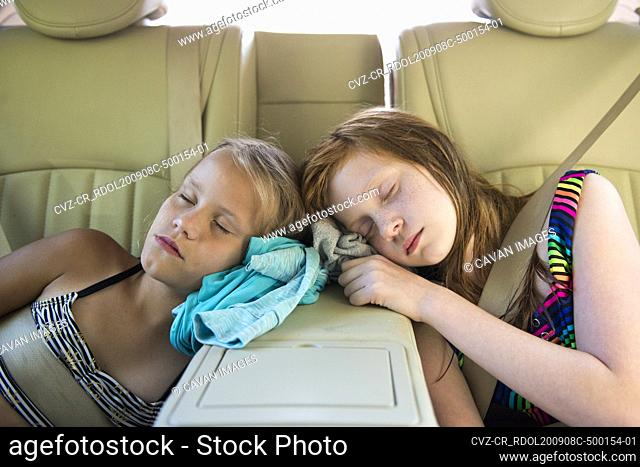 Two Young Girls Asleep in Car After Playing