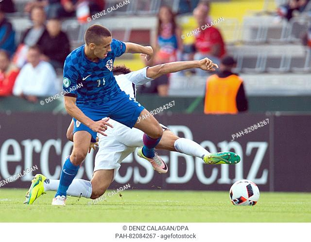 Croatia's Davor Lovren (l) and France's Denis Will Poha (r) compete for the ball during the UEFA European Under-19 Championship group B soccer match...